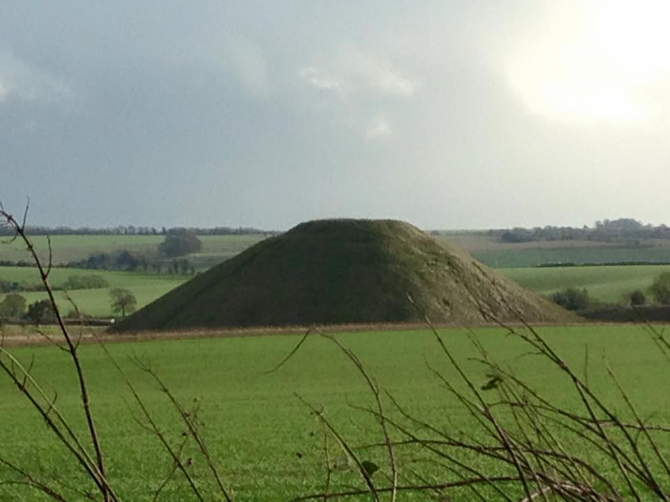 Silbury Hill- the ancient burial mound that stands nearby Avebury